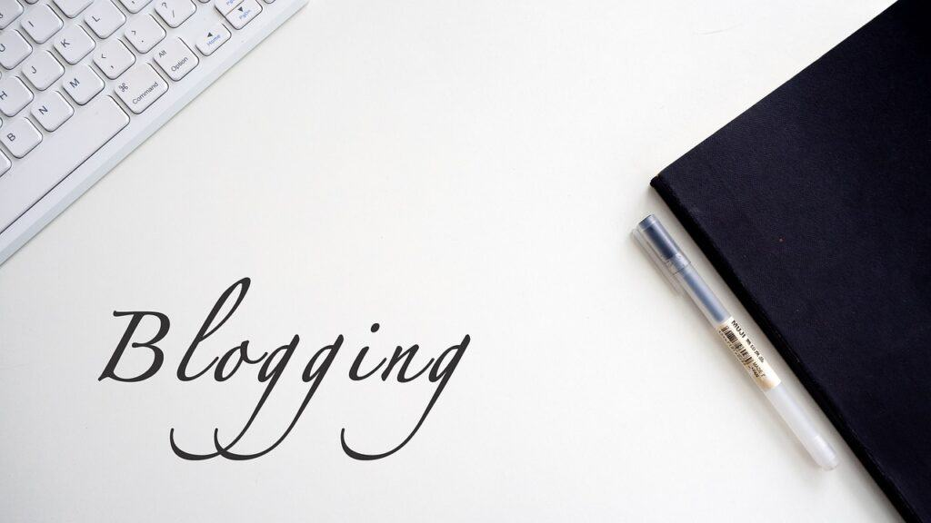 Blogging picture with a keyboard and notebook